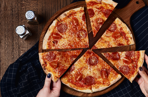 A pizza company makes data-driven decisions to support franchises in promoting profitability and selling slices at competitive menu prices with Datafiniti's Business Data.